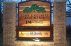 Apartment complex sign routered redwood with custom masonry