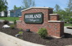 Highland Village sandblasted brick masonry subdivision sign